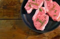 Pork steaks on pan Royalty Free Stock Images