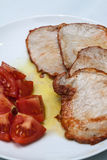 Pork steaks with tomato. Image of Pork steaks with tomato Royalty Free Stock Photos
