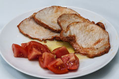 Pork steaks with tomato. Image of Pork steaks with tomato Royalty Free Stock Image
