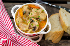 Pork stew with carrots and mushrooms in gravy Royalty Free Stock Images