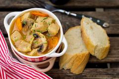 Pork stew with carrots and mushrooms in gravy Stock Image