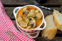 Pork stew with carrots and mushrooms in gravy Stock Photo