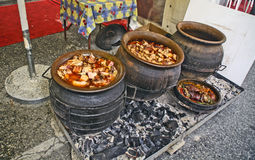Pork stew in a clay pot Stock Photography