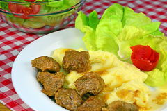 Pork stew with mashed potatoes. And vegetable salad stock image