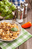 Pork stew with mushrooms, basil and red pepper. Stock Photos