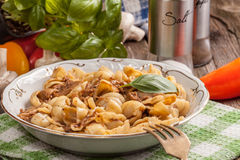 Pork stew with mushrooms, basil and red pepper. Stock Photography