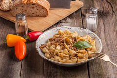 Pork stew with mushrooms, basil and red pepper. Royalty Free Stock Image