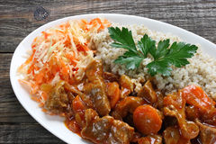 Pork stew with pearl barley Royalty Free Stock Photo