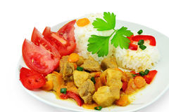Pork stew with rice. And vegetables on plate, isolated on white background Stock Photo