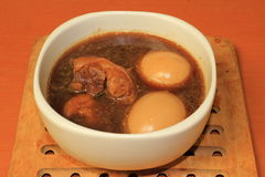 Pork stewed and egg in the gravy Stock Image