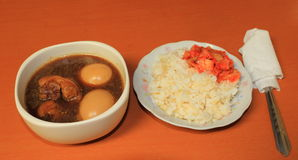 Pork stewed and egg in the gravy with rice and kimchi Royalty Free Stock Photos