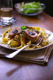 Pork stuffed with plums in cream sauce Royalty Free Stock Photos