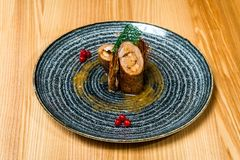 Pork stuffed with shrimp in a black plate royalty free stock photo