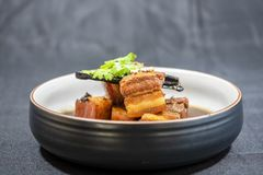 Pork in Sweet Brown Sauce,It`s in the sweet gravy on black background. stock image