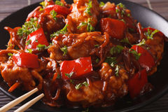 Pork in sweet and sour sauce with peppers, carrots and onions ma Royalty Free Stock Photography
