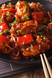 Pork in sweet and sour sauce with peppers, carrots and onions ma Stock Images