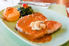 Pork T-bone steak. Pork steak on the table Royalty Free Stock Photo