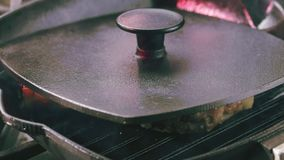 Pork T-Bone steak with covered lid. Pork T-Bone steak. Frying pan with covered lid stock video footage