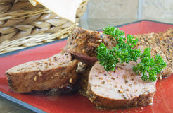 Pork Tenderloin. Sliced and stacked pork tenderloin garnished with parsley Royalty Free Stock Images