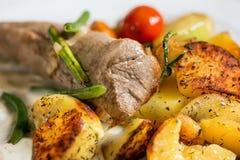 Pork tenderloin baked potatoes Stock Images