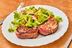 Pork tenderloin in dried ham  steak with salad