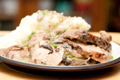 Pork tenderloin with mushroom gravy Royalty Free Stock Photography