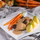 Pork tenderloin in plum sauce Stock Photography