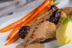 Pork tenderloin in plum sauce Royalty Free Stock Photo