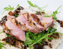 Pork tenderloin with risotto Stock Photos