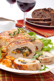 Pork Tenderloin Roulade. Feta-, spinach-, and bell pepper - stuffed pork tenderloin roulade garnished with sweet potato and green salad Royalty Free Stock Photos