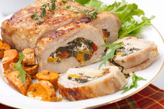 Pork Tenderloin Roulade. Feta-, spinach-, and bell pepper - stuffed pork tenderloin roulade garnished with sweet potato and green salad Stock Photography