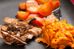 Pork tenderloin with sweet potato and carrot Royalty Free Stock Photography