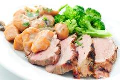 Pork tenderloin with sweet potato gnocchi Royalty Free Stock Photo