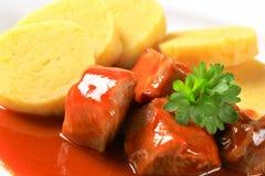 Pork in tomato sauce with potato dumplings Stock Photography
