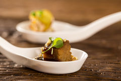 Pork tongue, ground banana, Marsala reduction, water meal and Mini watercress in a spoon. Taste gastronomy fingerfood Stock Image