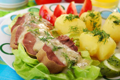 Pork tongue in horse radish and dill sauce. Dinner with stewed pork tongue in horse radish and dill sauce, boiled potatoes,vegetables Stock Photo
