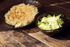 Pork under cheese with iceberg lettuce. And cucumber on the wooden background Royalty Free Stock Image