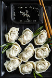 Pork and vegetable wonton with soy sauce. Top view stock photos