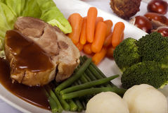 Pork with vegetables Stock Photos