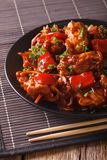 Pork with vegetables in a spicy sauce Asian style. vertical Stock Photos