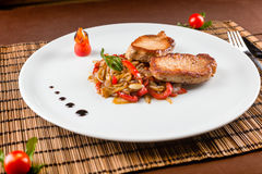 Pork with vegetables Stock Photos