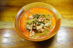 Pork with water spinach in coconut cream curry on bowl Stock Images