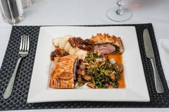 Pork wellington, creamed potatoes, pancetta, chestnut sauteed sa Stock Image