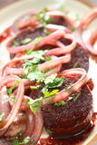 Pork in the wine with onion Royalty Free Stock Photography