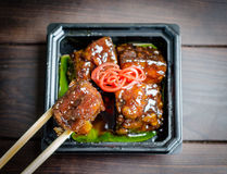 Pork on a wooden table with chopsticks Royalty Free Stock Photos