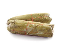 Pork wrapped in banana leaves. Royalty Free Stock Images