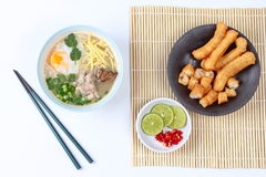 Pork's Rice porridge served with side dish. Royalty Free Stock Photography