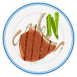 Porkchop i asparagus na talerzu Obrazy Stock
