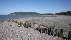 Porlock Weir beach Somerset coast England UK in summer PAN stock footage