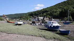 Porlock Weir beach Somerset on the Exmoor Heritage coast England UK in summer with boats stock footage